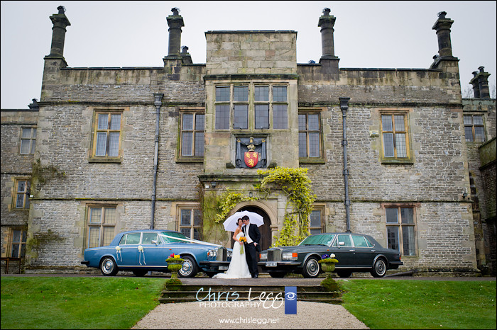 Bride and Groom outside Tissington Hall with Rolls Royce