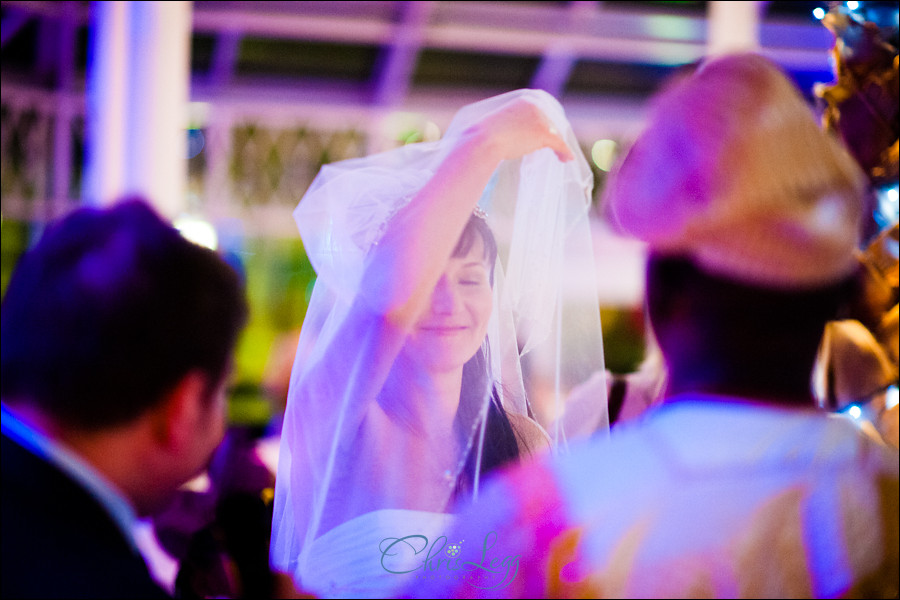 Colour shot of russian bride dancing with a veil over her face
