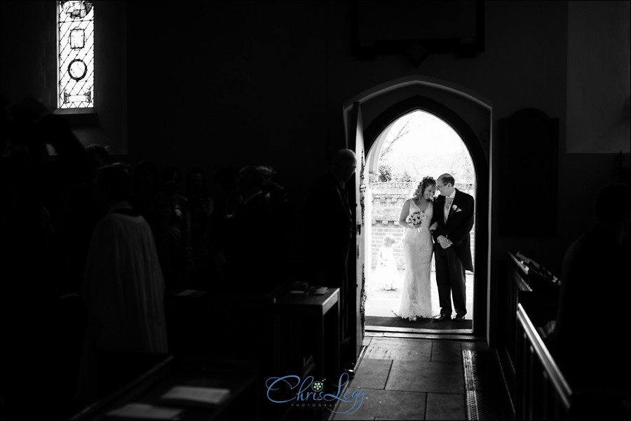 Bride and her father standing waiting to enter the church