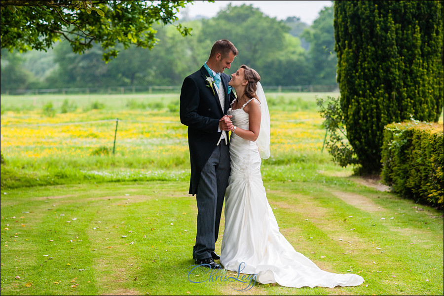 Bride and groom standing together in the gardens of Culeaze House