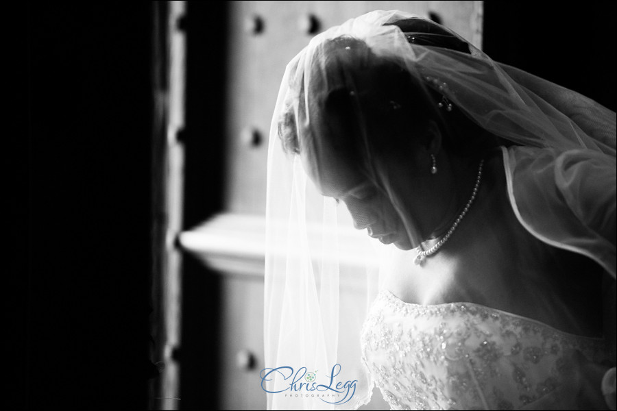 Bride waiting in the doorway of Sherborne Abbey