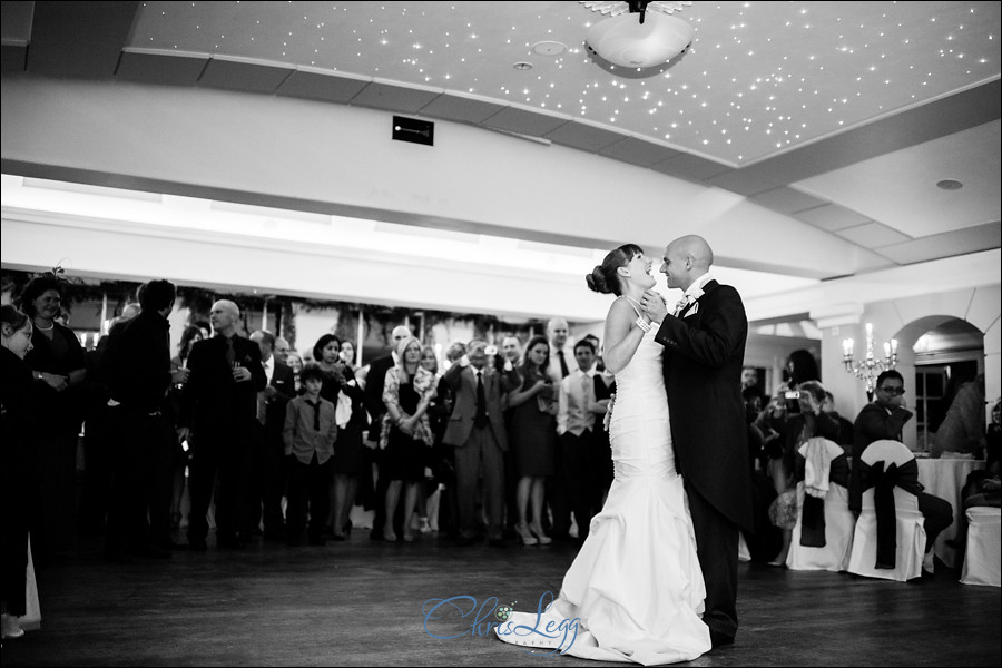 Bride and groom dance together at Pembroke Lodge