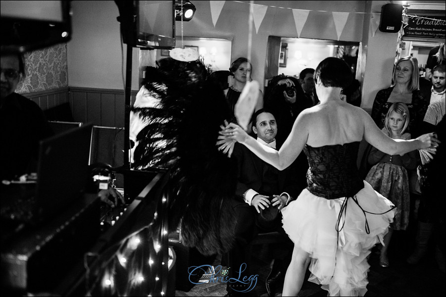 Bride giving the groom a burlesque dancing performance!
